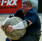 HAINAN ISLAND, CHINA - AUGUST 24:  Zydrunas Savickas of Lithuania competes at the Atlas Stones event during the World's Strongest Man competition at Yalong Bay Cultural Square on August 24, 2013 in Hainan Island, China.  Photo by Victor Fraile