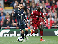 Manchester City's Bernardo Silva drives forward chased by Liverpool's Sadio Mane<br /> <br /> Photographer Rich Linley/CameraSport<br /> <br /> The Premier League - Liverpool v Manchester City - Sunday 7th October 2018 - Anfield - Liverpool<br /> <br /> World Copyright &copy; 2018 CameraSport. All rights reserved. 43 Linden Ave. Countesthorpe. Leicester. England. LE8 5PG - Tel: +44 (0) 116 277 4147 - admin@camerasport.com - www.camerasport.com