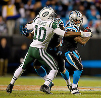 Sports action photography of the Carolina Panthers against the New York Jets during their NFL game at Bank of America Stadium in Charlotte, North Carolina. <br /> <br /> Charlotte Photographer - Patrick SchneiderPhoto.com