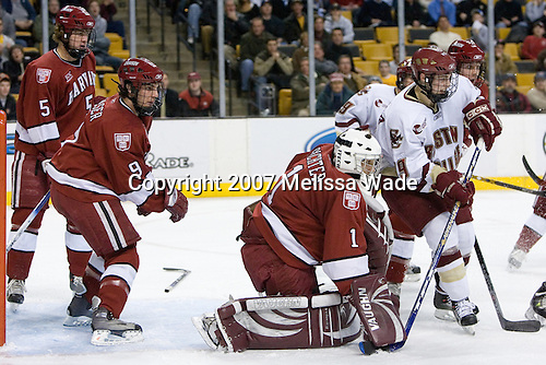 Jack Christian (Harvard University - Wilton, CT) and Jimmy Fraser (Harvard University - Port Huron, MI) help out behind Kyle Richter (Harvard University - Calgary, AB) and JD McCabe (Harvard University - Jamison, PA) in front with Nathan Gerbe (Boston College - Oxford, MI) and Brock Bradford (Boston College - Burnaby, BC). The Boston College Eagles defeated the Harvard University Crimson 3-1 in the first round of the 2007 Beanpot Tournament on Monday, February 5, 2007, at the TD Banknorth Garden in Boston, Massachusetts.  The first Beanpot Tournament was played in December 1952 with the scheduling moved to the first two Mondays of February in its sixth year.  The tournament is played between Boston College, Boston University, Harvard University and Northeastern University with the first round matchups alternating each year.