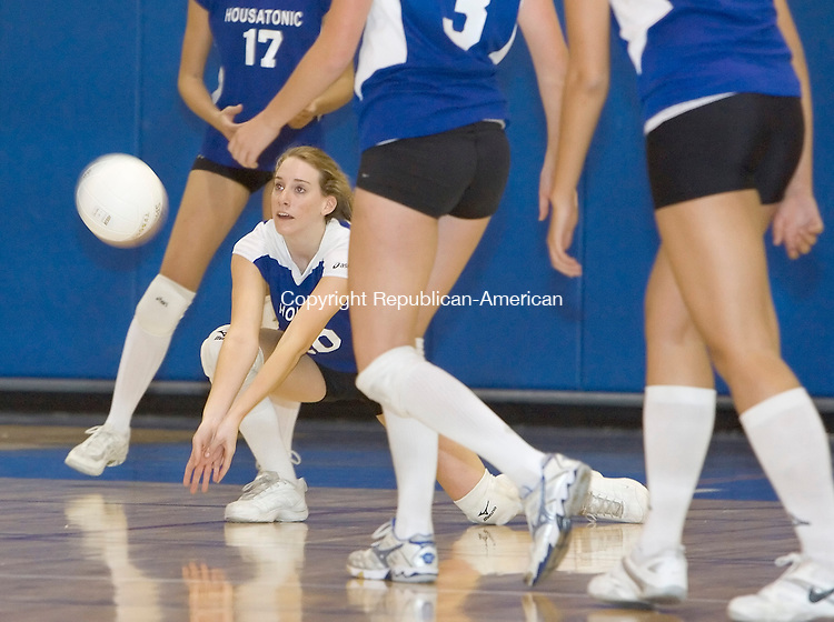 BURLINGTON, CT-- 02 NOVEMBER 2007--110207JS03-Housatonic's Sarah Godburn (20) digs for the ball during their  Berkshire League girls volleyball championship game against Terryville Friday at Lewis Mills High School in Burlington.<br /> Jim Shannon / Republican-American