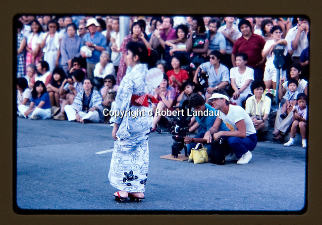 Ray Manzarek of thedoors with cameraman directing LA Woman video at Japanese Festival in downtown Los Angeles.