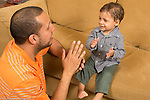 Young father with 16 month old toddler son, interaction, clapping hands