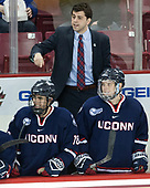 Max Kalter (UConn - 18), Joe Pereira (UConn - Assistant Coach), Alexander Payusov (UConn - 9) - The Boston College Eagles defeated the visiting UConn Huskies 2-1 on Tuesday, January 24, 2017, at Kelley Rink in Conte Forum in Chestnut Hill, Massachusetts.