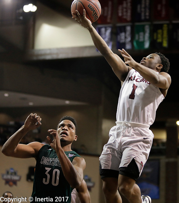 SIOUX FALLS, SD: MARCH 25:  Jason Jolly #1 of Fairmont State shoots past D'Vante Mosby #30 of Northwest Missouri State during the Men's Division II Basketball Championship game on March 25, 2017 at the Denny Sanford Premier Center in Sioux Falls, SD. (Photo by Dick Carlson/Inertia)