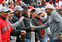 Gene Smith shakes hands with members of the 1968 National Championship Ohio State Buckeyes football team during a break in the first half of their game at Ohio Stadium in Columbus, Ohio on October 13, 2018. [ Brooke LaValley / Dispatch ]