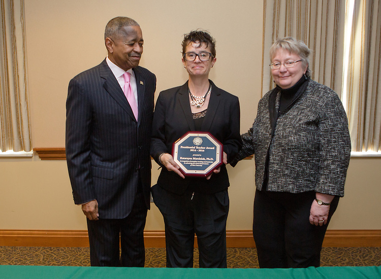 Ohio University President Roderick McDavis and Executive Vice President and Provost Pam Benoit congratulate Katarzyna Marciniak during the Presidential Teacher Awards in the Multicultural Center on Sept. 23, 2014. Photo by Lauren Pond