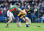 Conor Harrison of Clooney-Quin in action against Niall Gilligan of  Sixmilebridge during their senior county final replay at Cusack park. Photograph by John Kelly.