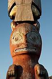USA, Alaska, Sitka, details of an old totem pole that stands in the center of town on the edge of Sitka Harbor