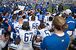 The football team listens to head coach Mark Stoops after the Blue/White Spring Game in Lexington, Ky., on Saturday, April 26, 2014. Blue defeated White 38-14. Photo by Adam Pennavaria | Staff