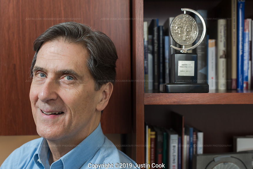 Portraits of Richard Riddell, Senior Vice President and Secretary to the Board of Trustees at Duke University, and his Tony Award from 1985 in Durham, North Carolina, Thursday, June 6, 2019  (Justin Cook)