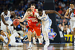 02 APR 2016: Guard Trevor Cooney (10) of Syracuse University battles with Forward Theo Pinson (1) of the University of North Carolina as they race down court during the 2016 NCAA Men's Division I Basketball Final Four Semifinal game held at NRG Stadium in Houston, TX.   North Carolina defeated Syracuse 83-66 to advance to the championship game.  Brett Wilhelm/NCAA Photos