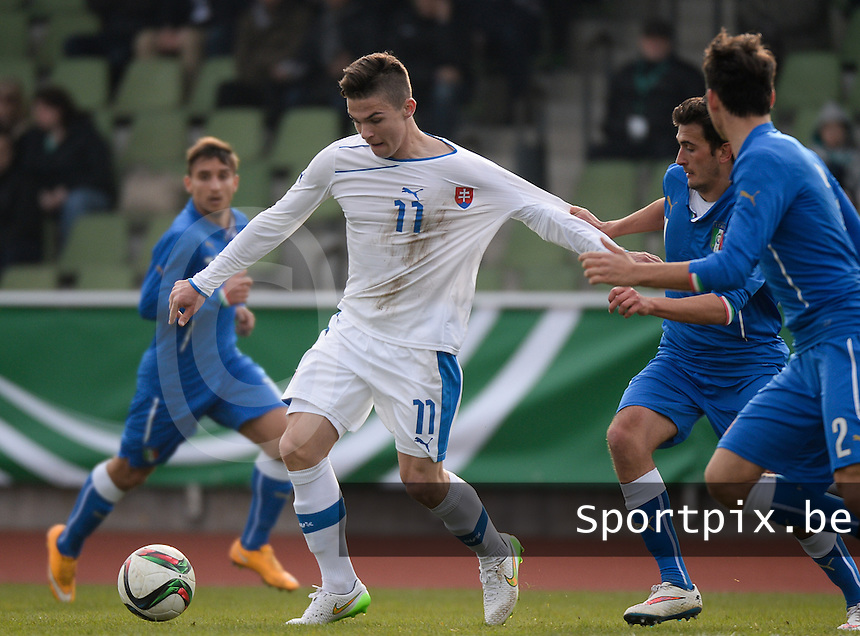 20150323 - MARBURG , GERMANY  : Slovakian Lubomir Tupta (11)  pictured being pulled at his shirt during the soccer match between Under 17 teams of Slovakia and Italy , on the second matchday in group 8 of the UEFA Elite Round Under 17 at Georg-Gassmann , Marburg Germany . Monday 23 rd  March 2015 . PHOTO DAVID CATRY