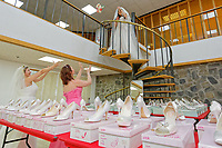 "COPY BY TOM BEDFORD<br /> Pictured L-R: Members of staff Sara Morris, Michelle Curry and Lara Williams, have fun while being dressed with some of the dresses at the John Pye Auctions warehouse in Pyle, south Wales, UK.<br /> Re: A bride cried tears of joy after her missing wedding dress was found among a pile of 20,000 gowns in a warehouse.<br /> Meg Stamp, 27, paid £1,300 for the beautiful ivory lace dress but it  was seized by liquidators after a bridal company went bust.<br /> It was boxed up along with 20,000 others and due to be sold for a knock-down price at auction.<br /> But determined Meg banged on the auctioneer door saying: ""I want my dress back"".<br /> Staff at John Pye auctioneers in Port Talbot spent three hours sifting through boxes until they finally found Meg's dream dress."