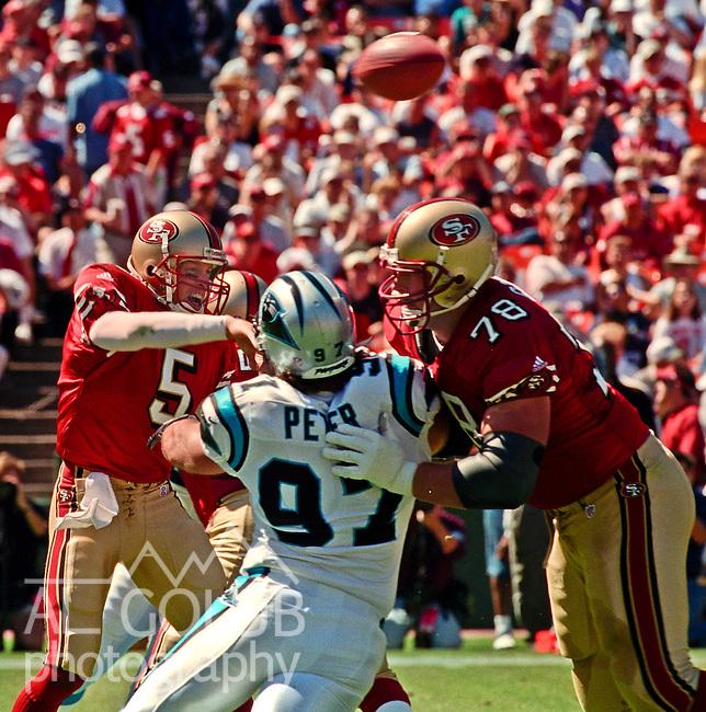 San Francisco 49ers vs. Carolina Panthers at Candlestick Park Sunday, September 10, 2000. Panthers beat 49ers 38-22.  San Francisco 49ers defensive tackle Scott Gragg (78) bucks Carolina Panthers defensive end Jason Peter (97) so 49ers quarterback Jeff Garcia (5) could get the ball away.