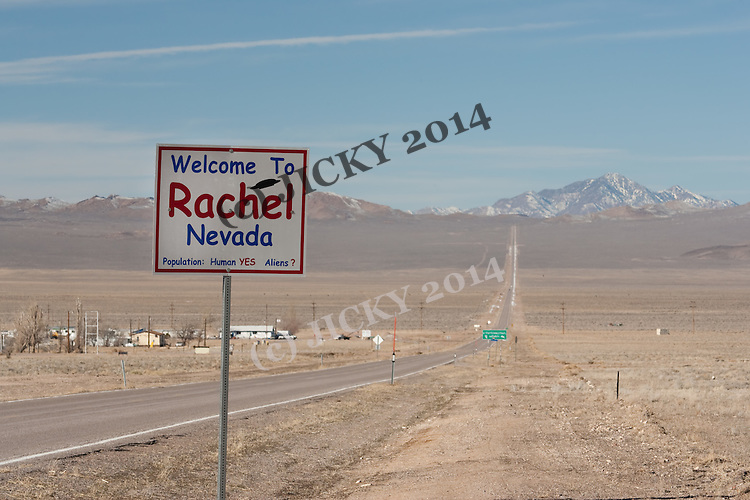 Rachel town sign with Rachel in background and hwy 375 - Extraterrestrial Highway