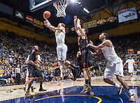 California's Ricky Kreklow shoots for the basket during a game against USC at Haas Pavilion in Berkeley, California on February 23th, 2014. California defeated USC 77 - 64