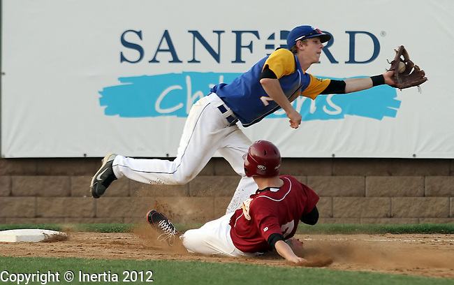 SIOUX FALLS, SD - MAY 26:  Ryan Leslie #2 from O'Gorman stretches for the ball as Lucas Wilber #7 from Roosevelt slides safely into third during the Class A Championship Game Saturday night at the Sioux Falls Stadium. (Photo by Dave Eggen/Inertia)