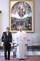 Pope Francis receives German Chancellor Angela Merkel during a private audience at the Vatican on May 18, 2013.