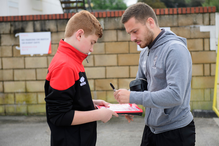 Lincoln City's Jack Payne signs an autograph for a fan after arriving at the ground<br /> <br /> Photographer Chris Vaughan/CameraSport<br /> <br /> The EFL Sky Bet League One - Lincoln City v Sunderland - Saturday 5th October 2019 - Sincil Bank - Lincoln<br /> <br /> World Copyright © 2019 CameraSport. All rights reserved. 43 Linden Ave. Countesthorpe. Leicester. England. LE8 5PG - Tel: +44 (0) 116 277 4147 - admin@camerasport.com - www.camerasport.com