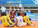 November 18 2011 - Guadalajara, Mexico:  Larry Matthews and Jose Rebelo of Team Canada block while taking on Columbia in the Bronze Medal Game in the Pan American Volleyball Complex at the 2011 Parapan American Games in Guadalajara, Mexico.  Photos: Matthew Murnaghan/Canadian Paralympic Committee