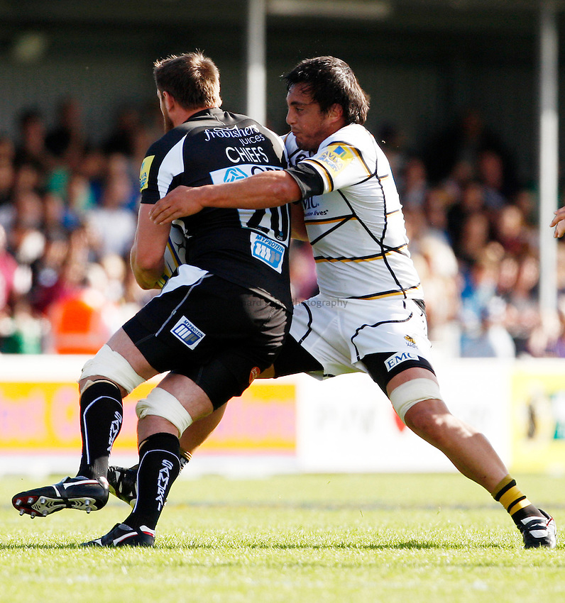 Photo: Richard Lane/Richard Lane Photography. Exeter Chiefs v London Wasps. Aviva Premiership. 25/09/2011. Wasps' Jonathan Poff tackles Exester's Ally Muldowney.
