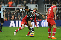 Kenedy of Newcastle United battles with Josh Sims of Southampton during Newcastle United vs Southampton, Premier League Football at St. James' Park on 10th March 2018
