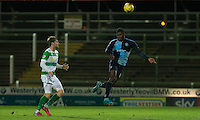 Aaron Pierre of Wycombe Wanderers heads clear during the Sky Bet League 2 match between Yeovil Town and Wycombe Wanderers at Huish Park, Yeovil, England on 24 November 2015. Photo by Andy Rowland.