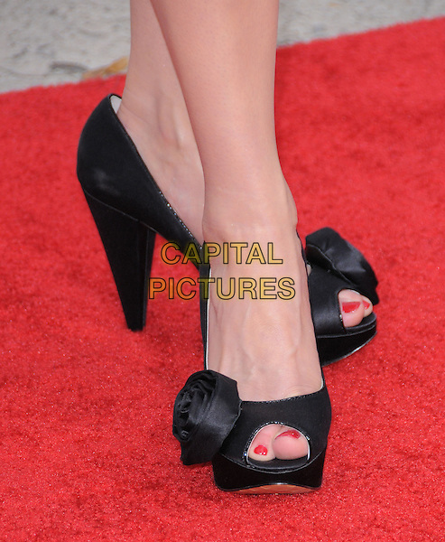 "MARIBETH MONROE's shoes .at the CBS Films' L.A. Premiere of ""The Back-Up Plan"" held at The Village Theatre in Westwood, California, USA, April 21st, 2010..arrivals black feet  peep toe shoes roses rosettes  .CAP/RKE/DVS.©DVS/RockinExposures/Capital Pictures."