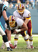 The Washington Redskins quarterback Patrick Ramsey (11) calls signals as he prepares to take the snap from center Lennie Friedman (64) against the Carolina Panthers at Ericsson Stadium in Charlotte, North Carolina on November 16, 2003.  The Panthers won the game 20 - 17. <br /> Credit: Arnie Sachs / CNP