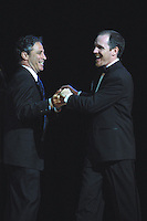 Comedians Jon Stewart and Greg Fitzsimmons  performed at The Gerry Red Wilson Found. Comedy Benefit to raise awareness for Spiral Meningitis at the Town Hall in New York City on June 11, 2002 as part of the Toyota Comedy Series.<br /> photo by Jen Lombardo/PictureGroup