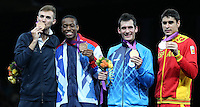11.08.2012. London, England. Gold medalist Sebastian Eduardo Crismanich of Argentina 2nd r Silver medalist Nicolas Garcia Hemme of Spain 1st r Bronze Medalists  Muhammad of Britain 2nd l and Mauro Sarmiento of Italy Pose at The Awards Ceremony of Mens Taekwondo 80kg Event London 2012 Olympic Games
