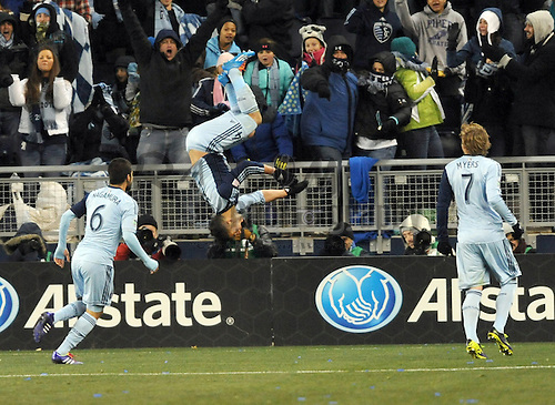 Nov 23, 2013; Kansas City, KS, USA; Sporting KC forward Dom Dwyer (14) celebrates after scoring a goal during the second half of the MLS Eastern Conference Championship soccer game against the Houston Dynamo at Sporting Park. Sporting KC won 2-1. Mandatory Credit: Denny Medley-USA TODAY Sports