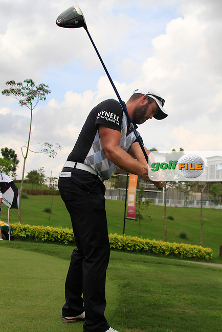 Christian Nilsson (SWE) warms up on the 1st tee to start his match during Saturday's storm delayed  Round 3 of the Iskandar Johor Open 2011 at the Horizon Hills Golf Resort Johor, Malaysia, 19th November 2011 (Photo Eoin Clarke/www.golffile.ie)
