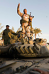 MAHDY BELEID ON TOP OF A TANK FROM GADAFFI'S FORCES, CAPTURED THIS MORNING BY RESIDENTS, SOME OF WHOM ATTACKED IT WITH STONES.. BENGHAZI, LIBYA..19-3-2011 PIC BY IAN MCILGORM