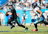 CHARLOTTE, NC - NOVEMBER 3: Kyle Allen #7 of the Carolina Panthers is chased by Sharif Finch #56 of the Tennessee Titans during a game between Tennessee Titans and Carolina Panthers at Bank of America Stadium on November 3, 2019 in Charlotte, North Carolina.