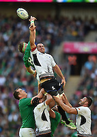 Jamie Heaslip of Ireland and Daniel Carpo of Romania compete for the ball at a lineout. Rugby World Cup Pool D match between Ireland and Romania on September 27, 2015 at Wembley Stadium in London, England. Photo by: Patrick Khachfe / Onside Images