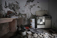 In this Monday, Dec. 10, 2012 photo, a destroyed kitchen is seen from a residential house after months of heavy fighting between Syrian rebels and troops loyal to President Bashar al-Assad in Aleppo, Syria. (AP Photo/Narciso Contreras)