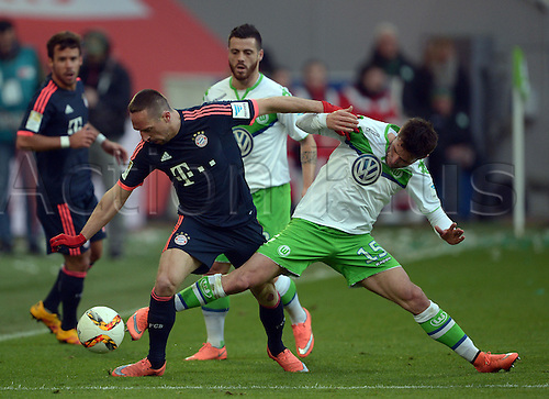 27.02.2016. Wolfsburg, Germany.  Wolfsburg's Christian Traesch (r) and Munich's Franck Ribery compete for the ball during the German Bundesliga football match between VfL Wolfsburg and FC Bayern Munich at the Volkswagen-Arena in Wolfsburg, Germany