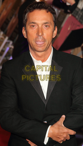 Bruno Tonioli.W.E. Uk film premiere at Odeon cinema, Kensington, London, England..11th January 2011.half length black suit jacket white shirt tongue funny .CAP/ROS.©Steve Ross/Capital Pictures.