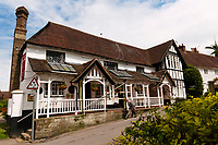The Anchor pub in Hartfield Village, near Ashdown Forest, Sussex, UK, May 20, 2017. Picturesque Ashdown Forest stretches across the countries of Surrey, Sussex and Kent, and is the largest open access space in the South East of England. It is famous as the geographical inspiration for the Winnie the Pooh stories and is popular with fans of the characters.