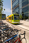 Parked commuter bicycles and streetcar at the OHSU Center for Health and Healing building, South Waterfront, Portland, Oregon