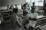 Children pray in a primary school on February 8, 2002 in Loisevale, Upington, South Africa. Loisevale, a poor and destitute colored/black township where unemployment is high, and many social problems including domestic violence and alcohol abuse. Baby Thsepang, an 8-month old baby was raped here by her father in October 2001. The baby rape shocked the country, and it?s struggling with an increase of rapes and abuse of young children. The country has the highest number of rapes in the world. (Photo: Per-Anders Pettersson)