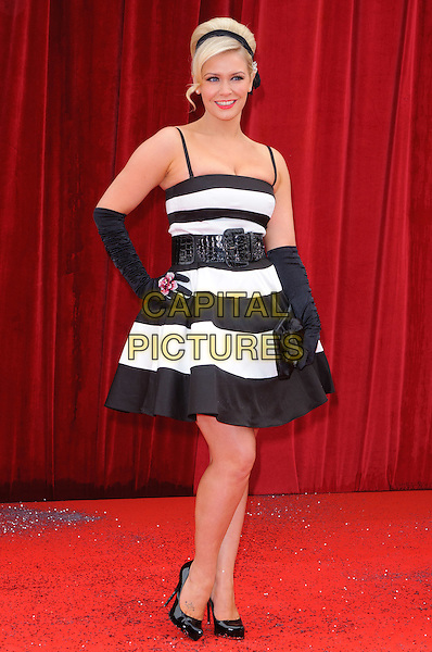 SUZANNE SHAW.Arrivals at the British Soap Awards at Granada Television Studios, Manchester, England..May 14th, 2011.full length black and white striped dress hand on hip gloves belt shoes .CAP/CJ.©Chris Joseph/Capital Pictures.