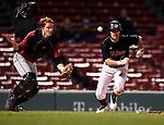 BOSTON, MA - APRIL 17: UMass' Ryan Lever, right, runs to first as Harvard catcher Jake Allen scrambles for the ball in the ninth inning during the 30th Annual Baseball Beanpot Championship Game at Fenway Park in Boston, Massachusetts on April 17, 2019. Photo by Christopher Evans