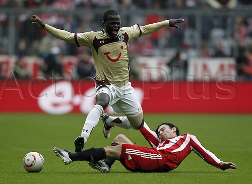 16 11 2010  Bundesliga 2010 2011 8 Matchday Alliance Arena in Munich FC Bavaria Munich versus Hanover 96 Danijel Pranjic right Red Bavaria in duel with Didier Ya Konan left Gold Hanover