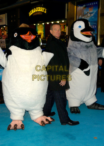 "ROBIN WILLIAMS & PENGUINS.Attends the European Film Premiere of ""Happy Feet"" .Empire Cinema, leicester Square, London, England,.November 26th 2006..full length funny black coat chequered tartan plaid trousers characters costumes.CAP/CAN.©Can Nguyen/Capital Pictures"