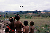 Roraima, Brazil. Yanomami children watching military operations at Surucucu airstrip.