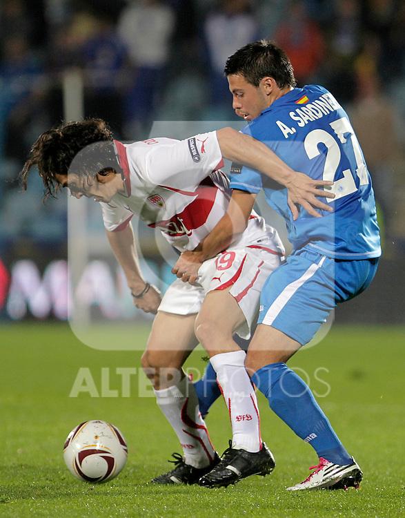 Stuttgart's Mauro Camoranesi (l) and Getafe's Adrian Sardinero during UEFA Europa League match.November 04,2010. (ALTERPHOTOS/Acero)