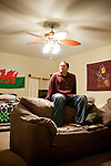 Derek Figg sits in the bedroom of his Tempe, Arizona home December 15, 2009. He stopped making mortgage payments in September. Mr. Figg bought the home in September 2007 and is moving out Sunday. CREDIT: Kendrick Brinson/Luceo Images for The Wall Street Journal